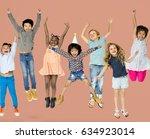 diverse group of kids jumping... | Shutterstock . vector #634923014