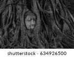 head of buddha statue in the... | Shutterstock . vector #634926500