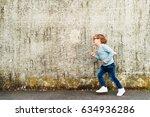 outdoor portrait of a cute... | Shutterstock . vector #634936286