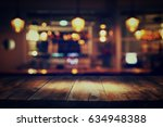 image of wooden table in front... | Shutterstock . vector #634948388