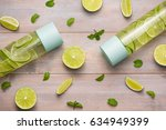 Stock photo detox infused water with lime and mint in sports bottle with slices of lime 634949399