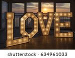 love in one metre high letters... | Shutterstock . vector #634961033