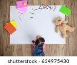 little asian girl drawing in...   Shutterstock . vector #634975430