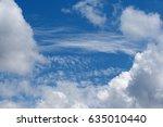 Dense Cloud And Wispy Clouds