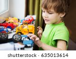 little boy plays with toy car... | Shutterstock . vector #635013614