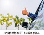 male hand thumbs up in car | Shutterstock . vector #635055068