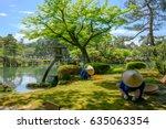 Japanese Gardener Near The Tor...