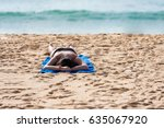 Woman Relaxing On The Beach Of...