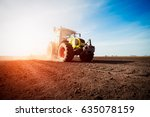 tractor working on farm land on ... | Shutterstock . vector #635078159