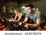 attractive woman and man biking ... | Shutterstock . vector #635078294