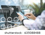 close up of smartphone in hands ... | Shutterstock . vector #635088488