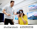 couple enjoying with vr goggles ... | Shutterstock . vector #635090558