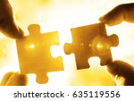 two hands trying to connect... | Shutterstock . vector #635119556