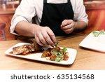 chef is decorating chicken... | Shutterstock . vector #635134568