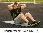 fitness man doing sit ups in... | Shutterstock . vector #635137214