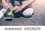 women tie the chain of jogging... | Shutterstock . vector #635150270