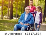 happy wheelchair man with... | Shutterstock . vector #635171534