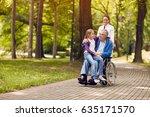 nurse pushing senior man on... | Shutterstock . vector #635171570