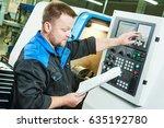 industrial worker operating cnc ... | Shutterstock . vector #635192780
