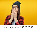 hipster girl cover mouth with... | Shutterstock . vector #635202539