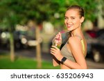 young woman drink smoothie... | Shutterstock . vector #635206943