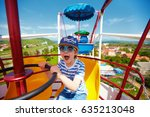 excited kid riding on ferris... | Shutterstock . vector #635213048