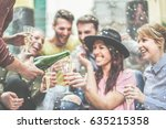 happy friends celebrating... | Shutterstock . vector #635215358