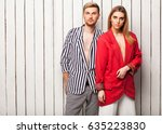 fashion couple standing near a... | Shutterstock . vector #635223830
