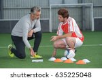 football trainer and the player ... | Shutterstock . vector #635225048