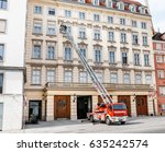 Small photo of VIENNA, AUSTRIA - MARCH 23, 2017: Firefighters with a car on an extended staircase near a multi-storey building