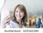 beautiful asian girl making... | Shutterstock . vector #635262284