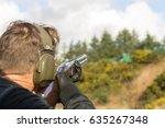 Man Shooting Shotguns At Clay...