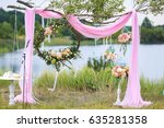 wedding arch with flowers for...   Shutterstock . vector #635281358