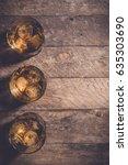 whiskey glasses on an old... | Shutterstock . vector #635303690