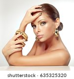 beautiful girl with golden... | Shutterstock . vector #635325320