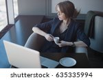 the bussineswoman in the cafe... | Shutterstock . vector #635335994