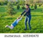 beautiful mother lifts high her ... | Shutterstock . vector #635340470