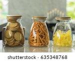 three jars of delicious snacks. | Shutterstock . vector #635348768