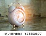 clock placed on cement floor. | Shutterstock . vector #635360870