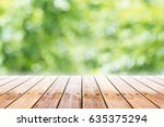 empty wooden table with party... | Shutterstock . vector #635375294