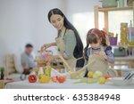 family of kid girl and mom... | Shutterstock . vector #635384948