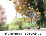 alarm clock and shopping cart ... | Shutterstock . vector #635392478
