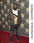 lil rel howery attends ... | Shutterstock . vector #635396654