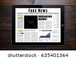 online news on tablet showing ... | Shutterstock . vector #635401364