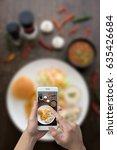man hand taking photo steak... | Shutterstock . vector #635426684