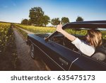 female driver shows thumbs up | Shutterstock . vector #635475173