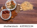 assorted nuts in white bowl ... | Shutterstock . vector #635502134