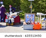 Small photo of ECHING, GERMANY - APRIL 30, 2017 - the open air spring flea market, visitors looking for bargain and objects exposed on the sidewalk in Eching, Bavaria, Germany.