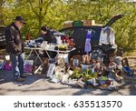 Small photo of ECHING, GERMANY - APRIL 30, 2017- the open air spring flea market, visitors looking for bargain and objects exposed on the side of the street in Eching, Bavaria, Germany.