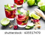 raspberry mojito cocktail with... | Shutterstock . vector #635517470